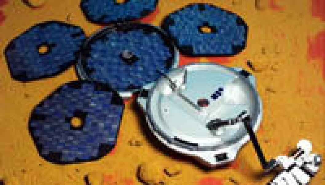 """""""Slik ser Beagle2 ut etter landing. Før den har brettet seg ut, kan den minne om et armbåndsur. (Illustrasjon: ESA)"""""""