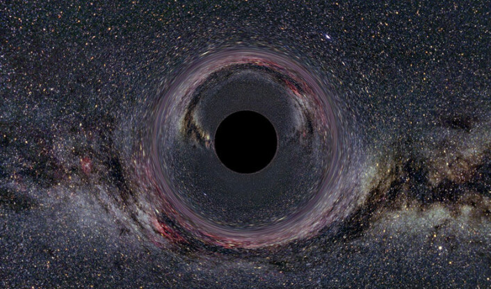 """""""Et tenkt sort hull med ti ganger solens masse, sett fra en avstand på 600 km, med Melkeveien i bakgrunnen. (Illustrasjon: Wikimedia Commons)"""""""