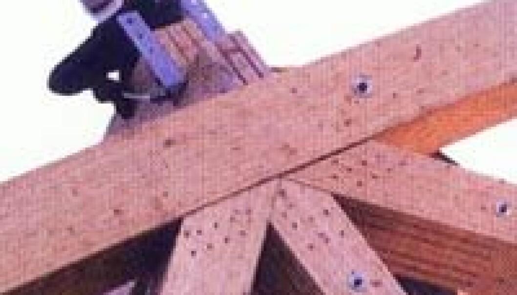 """""""Massivtre i store dimensjoner er en vekstnæring i Norge. Både terminalbygget på Gardermoen og Vikingskipet på Lillehammer er konstruert på denne måten. (Foto: Tresenteret)"""""""