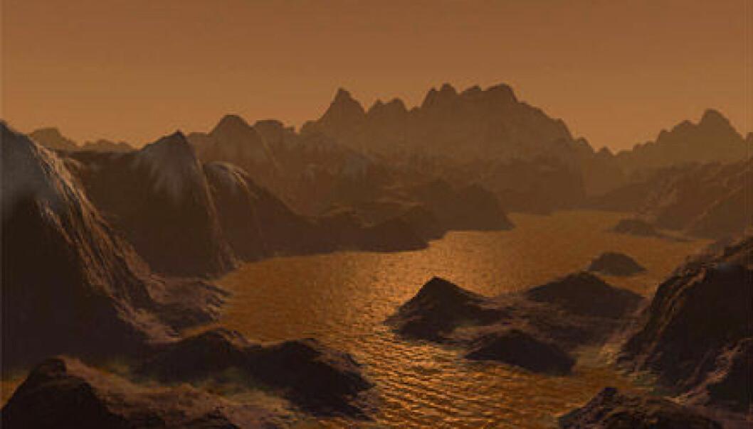 """""""Titan, Saturns største måne. Her finnes høye fjell og innsjøer fylt med hydrokarbon. Titan har også en atmosfære. I likhet med jordens består den hovedsaklig av nitrogen. Saturns største måne har også is og nedbør i form av hydrokarboner. Bildet er en illustrasjon."""""""