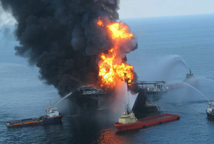 Platform supply vessels battle the blazing remnants of the off shore oil rig Deepwater Horizon. A US Coast Guard MH-65C dolphin rescue helicopter and crew documented the fire on the mobile offshore drilling unit Deepwater Horizon, while searching for survivors. Multiple Coast Guard helicopters, planes and cutters responded to rescue the Deepwater Horizon's 126 person crew.